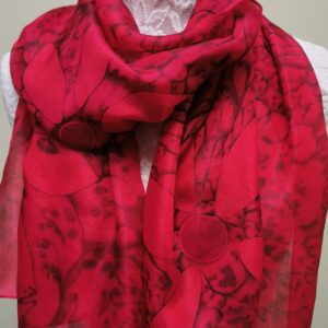 Red scarf with flower detail.